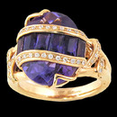 A unique Amethyst 18K gold ring from Bellarri. The Amethyst has a total carat weight of 6.65. The diamonds that cross the Amethyst have a total weight of 0.18.