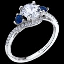 A beautiful Ladies 14kt White Gold Radiance Mounting with Sapphire Accents .45ctw from luxury designer Scott Kay. The shoulder of the ring has a unique diamond setting that wraps around the sapphires and center diamond. The suggested size for the center diamond is 1 carat. This ring is also available in Platinum and 18kt white Gold.