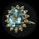 A gem quality aquamarine.  This ring is 18kt yellow gold and contains a 3.42ct. oval gem quality aquamarine surrounded by .45ct. VS F-G total weight in diamonds.  Size 6  16mm at the widest.