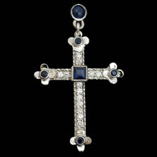 Gorgeous 18kt white gold sapphire and diamond cross.  The piece is set with 1.40ct of sapphires and .65ct of diamonds.  VS G-H quality.