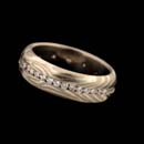 A gorgeous 14kt grey gold and sterling silver symmetry diamond wedding band by George Sawyer.  This piece is set with .60ctw of diamonds. The ring is 6mm in width.
