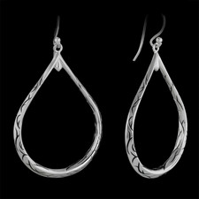 These are a pair of sterling engraved hooped earrings designed by Scott Kay Sterling.