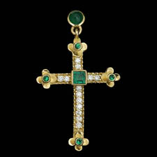 Wonderful 18kt gold emerald and diamond cross.  The piece is set with 1.02ct of gem emeralds and .39ct of diamonds. VS G-H quality.