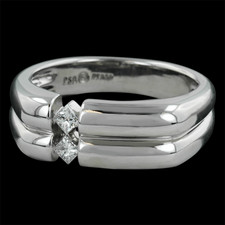 Platinum Naked Diamonds� men's wedding band, with rounded profile, contrasting two perfectly cut princess cut diamonds, highlighted by the skin of the wearer, designed by Peter Storm.