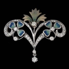A beautiful 18kt white gold brooch designed by Nouveau Collection, with diamonds and gorgeous enamel work. This piece can also be worn as a pendant.
