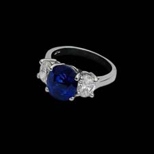 This clean and classic platinum ring from the Pearlman's Collection features a 4.99ct. center sapphire flanked by 1.40cts. in brilliant oval diamonds.