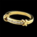 Item 325CO1 - 18kt yellow gold diamond wedding/fashion 'Kiss' band by Jeff Cooper NYC.  The ring is set with 7 ideal cut VS F-G quality diamonds weighing .21ct total. The band measures 4mm to 2.5mm and is a size 6.  Solid ring.