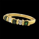 A beautiful 18kt gold natural gem green Tsavorite garnet and diamond band. The ring is set with 3, 3.0mm intense green Tsavorites and 2 .10ct, .20ct tw VS F-G ideal cut diamonds. The band is 3.4mm in width.  Size 6 1/2.  Pretty!