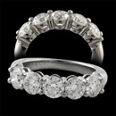 A wonderful platinum (950) signed Tiffany & Co 5 diamond shared prong band. The diamonds are gem quality VS1+ F ideal cut diamonds.  Approximate diamond weight 2.30ct. Heavy 8.92gram mounting in mint condition, Virtually no wear. Size 6 1/2. Tiffany retails this ring for over $27,000.00. Very impressive!