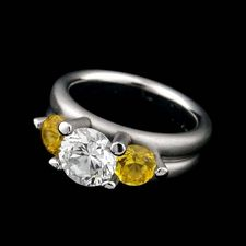 Whitney Boin platinum post triad mount engagement ring with yellow sapphire sides.