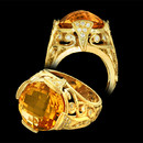 Cathy Carmendy's gorgeous 20k gold scroll tower ring with 10 ct citrine.  The citrine measures 14mm and is a double sided faceted gemstone with .50ctw of diamonds of VS2 clarity and G color.