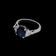 This beautiful platinum engagement ring from the Pearlman's Collection features a round 3.17 blue sapphire framed by .94cts. in diamonds.