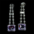 These ''One of a Kind'' diamond and amethyst earrings by Gumuchian are done in platinum.  The baguette shaped amethysts have a total weight of 16.37ct.  They are suspended from a drop that contains baguette and round diamonds with a total weight of 2.35ct. The earrings dangle 1 3/4 inches in length.
