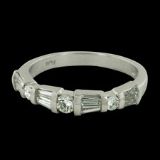 Beautiful platinum and diamond wedding band by Sasha Primak.  The mounting contains a combination of round and baguette diamonds.  The total diamond weight is .44ct.