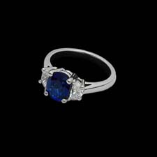 This simply stunning platinum ring from the Pearlman's Collecton features a 2.08 center sapphire enhanced by .63cts. in diamond side stones.