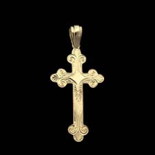 Scroll engraved 18kt yellow gold cross.
