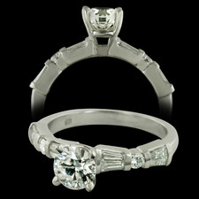 This beautiful platinum and diamond engagement ring contains a .74ct. Eight Star diamond in the center.  The stone is a certified diamond with a clarity grade of SI 1 and a color grade of F.  The mounting contains a combination of rounds and baguette diamonds with a total weight of .52ct.