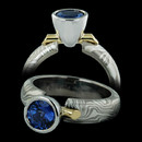 George Sawyer sapphire and 14kt. grey gold engagement ring with sterling silver and 18kt yellow accent bar.  This is a bell setting with a platinum head and and is 5.0mm in width.  Blue sapphire not included.