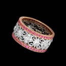 This beautiful 9.5m 18K white and rose gold wedding ring features diamonds weighing .45ct. total weight and pink sapphires weighing a total of .94ct.