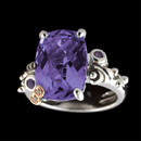 A sterling silver amethyst ring from the Madam B collection of Bellarri. The amethyst has a total carat weight of 6.58 and the rhodolite has a weight of 0.10.