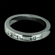 A beautiful platinum and diamond channel set wedding band designed by Sasha Primak. This piece features a total weight of .60cts of round and baguette cut channel set diamonds. The finger size is 5.75.