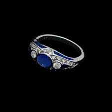 This delightful platinum ring from the Pearlman's Collection features a .92ct. sapphire center stone flanked by .21cts. in round diamonds. The bezel is set with .26cts. in sapphires and .26cts. in diamonds.