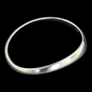 Item 39G4 - This beautiful curve bangle bracelet has a satin finish and is in sterling silver.  This piece is available in sizes S/M and M/L.
