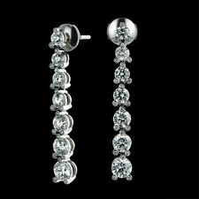Platinum Twinset Journey diamond earrings by Gumuchian.  These earrings contain a total diamond weight of over 4.0ct.  The diamonds vary in size from .15ct. to .50ct. and there are even diamonds bezel set on the prongs.  The earrings dangle to a length of 1 1/2 inches.