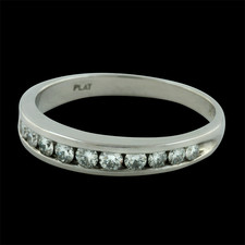 This beautiful ladies Platinum channel diamond band contains .31ct. total weight in diamonds. The ring is 3mm in width and the diamonds are VS F-G