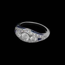 This gorgeous platinum ring features 1.00cts. in round center diamonds and .26cts. in melee enhancing diamonds and .90 in side sapphires.