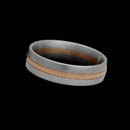 Designed by Christian Bauer, this sophisticated 6mm wedding band is created in platinum and set with 18K red gold in the center.