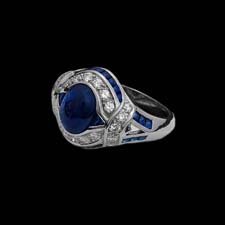 This gorgeous and unique platinum ring from the Pearlman's Collection features an impressive 2.73ct. cabechon sapphire surrounding by bands of melee diamonds (.46cts.) and sapphires (.90cts.).