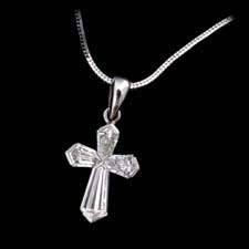 This is the most beautiful diamond cross pendant that we have seen. The diamonds are hand cut to make the design. The cross measures 12mm in length and contains .61ctw of diamonds. Available in larger sizes.