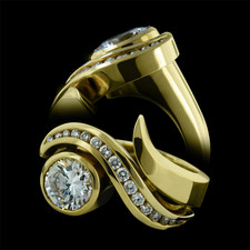 An 18kt yellow gold ring by Eddie Sakamoto. This stunning ring contains a total of .40ctw of diamonds.