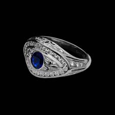 Gorgeous platinum 'swirl' ring set with .73cts. in diamonds surrounding a .66cts. blue sapphire center stone.