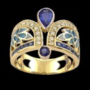 Something blue? This artistic design of an art nouveau inspired ring is made from 18k gold and features enameled blue leafs between a row of diamonds and sapphires. There are 20 diamonds all together with a total carat weight of 0.33tcw. The total amount of blue sapphires are 16 with a total carat weight of 1.04tcw. The measurements of the ring are 16mm x 21mm and weighs 8.20 grams.