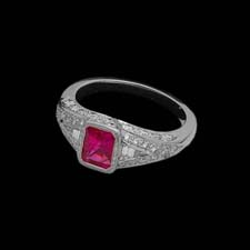 This gorgeous platinum ring shimmers with .90cts. of diamonds and features a square-cut 1.15ct. pink sapphire.