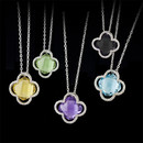 These are the larger version of our 46EE3 pendant. A great fashion accessory wonderful for brides maid gifts, stocking stuffers, or a simple, but beautiful fashion accessory. These sterling silver gemset pendants are set with clover leaf checker board gemstones of lemon quartz, amethyst, blue topaz, smoky quartz, and aqua quartz. The pendants measure 27mm in width. The pendants are suspended from 18 inch cable link chains with lobster claw clasps. Made in the USA!