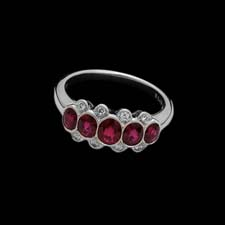 Platinum and Ruby ring.  This ring contains 1.46cts in 5 rubies and .09 in 8 diamonds.