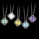 A beautiful fashion accessory is what these clover shaped checker gem set pendants are about. Set with amethyst, rose quartz, citrine, lemon quartz, black onyx, blue topaz, green amethyst, smoky quartz, aqua quartz, and white onyx. Perfect for brides maids gifts, stocking stuffers, or just by themselves. The pendants measures 17mm in width.  The pendants are suspended from 18 inch cable link chain with lobster claw clasps. The pendants measure 17mm in width.  Made in the USA!