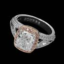 This antique-inspired platinum and rose gold Michael Beaudry engagement ring features a 3.02ct. cushion-cut center diamond with a pink stiletto bezel. Fancy pink diamonds (.23ctw) surround the center stone. This is a custom created piece.