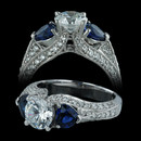 Spark engagement ring with two heart shape sapphires weighing 1.30carats in total.  Set in 18kt white gold with round diamonds totaling 0.53 carats in total. The ring accommodates a center diamond from 1.00 to 2.00 carats. Center stone not included.