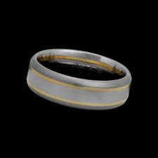 Christian Bauer designed this clean platinum, 18K white and 18K yellow gold wedding band. The ring measures 7mm.