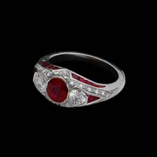 This lovely platinum and ruby ring features a 1.15ct. ruby center stone flanked by .54cts. in diamonds. The ring is enhanced with .22cts. in melee diamonds.