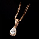Our classic pear shaped diamond solitaire pendant with our diamond cut cable 14kt pink gold chain and handmade 18kt gold mounting. We make these from 1/4ct and larger and in 18kt white, yellow gold, and platinum. All diamonds are ideal cuts. Just pretty. This is the 1/4ct pendant.This pendant can be made in all shapes of diamonds or colored gemstones. All mountings are made in the America