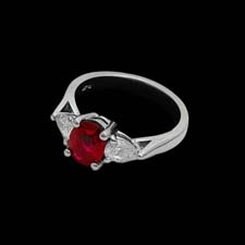 Simply stunning: this clean and classic platinum ring shines with a 1.61ct. ruby flanked by .70cts. in side diamonds.