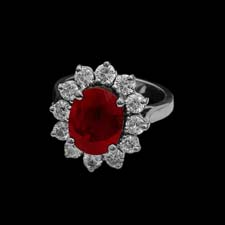 This gorgeous platinum cocktail ring features a 5.02 round ruby center stone surrounded by 1.35cts. in brilliant diamonds.