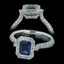 From Spark's Classico Collection. This blue sapphire engagement ring is set in 18kt white gold with 0.63 carats total weight in round diamonds and a 1.20ct emerald cut sapphire.