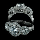 A stunning platinum three stone halo design from Durnell. Features .54ct in side stones and an additional .50ct in melee. Flowing hand engraving and filigree work complete this timeless setting. Center stone sold separately.