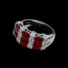 Exclusive from the Pearlman's Collection, this tri-stacked platinum ring shines with three rows of rubies (2.65cts.) separated by diamond stripes (.27cts.).